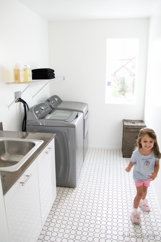 Beautiful light and bright and full of natural light laundry room. Fabulous Laundry room design ideas from @Remodelaholic (56 of 103)