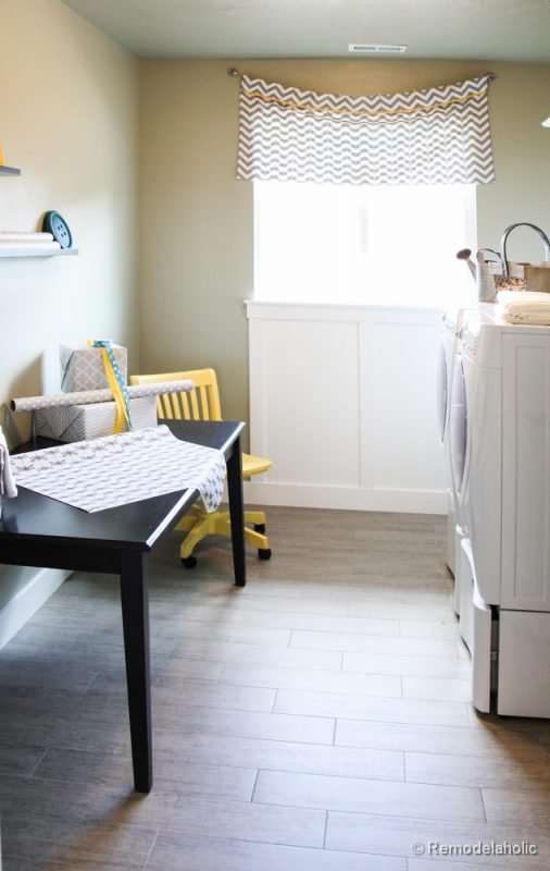 Add a table or desk to a laundry room to add a work station area. Fabulous Laundry room design ideas from @Remodelaholic