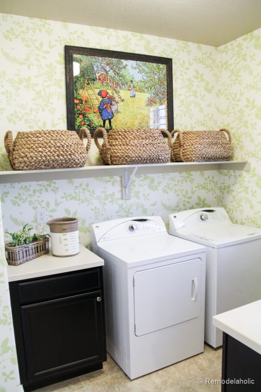 Add shelving for baskets above machines in the laundry room. Fabulous Laundry room design ideas from @Remodelaholic