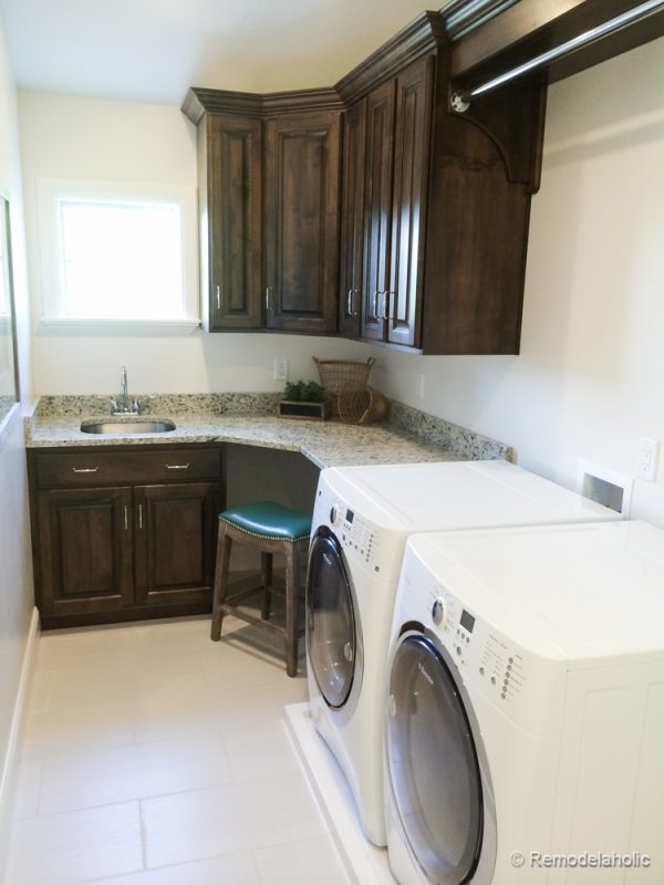 Simple laundry room idea. Fabulous Laundry room design ideas from @Remodelaholic