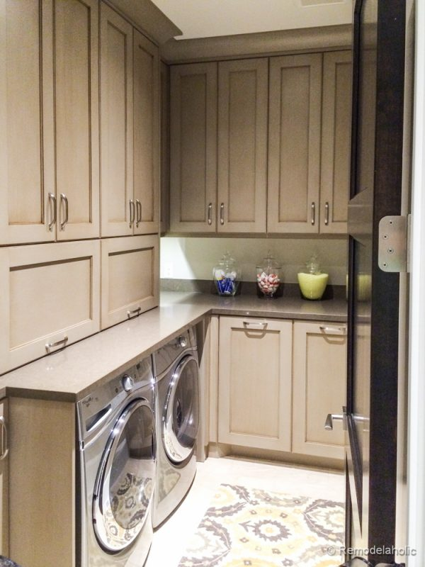 Tall cabinets add extra storage to this laundry room. Fabulous Laundry room design ideas from @Remodelaholic