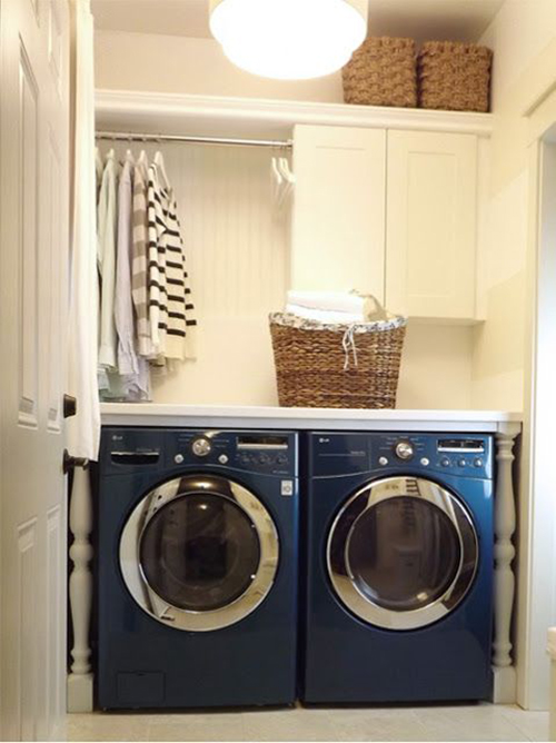 Fun detail with newel posts and counter and air drying laundry room featured on Remodelaholic.com