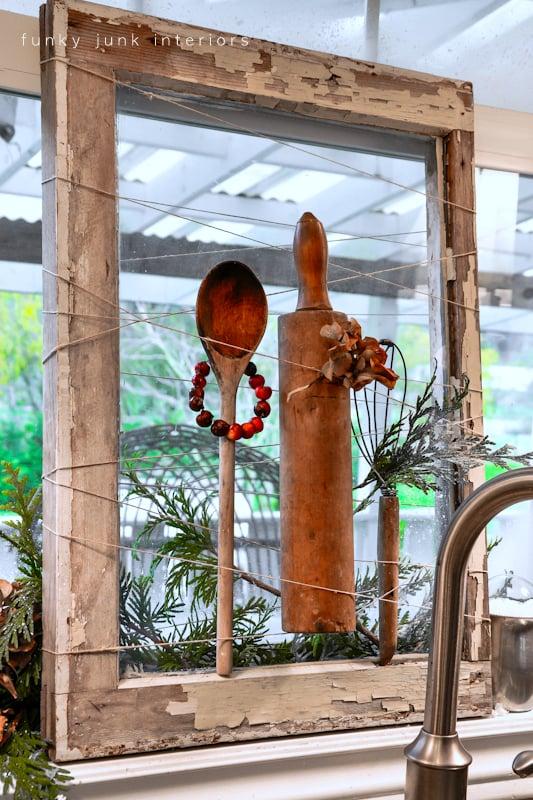 Funky Junk Interiors - old window as a memorabilia holder or seasonal display with twine - via Remodelaholic