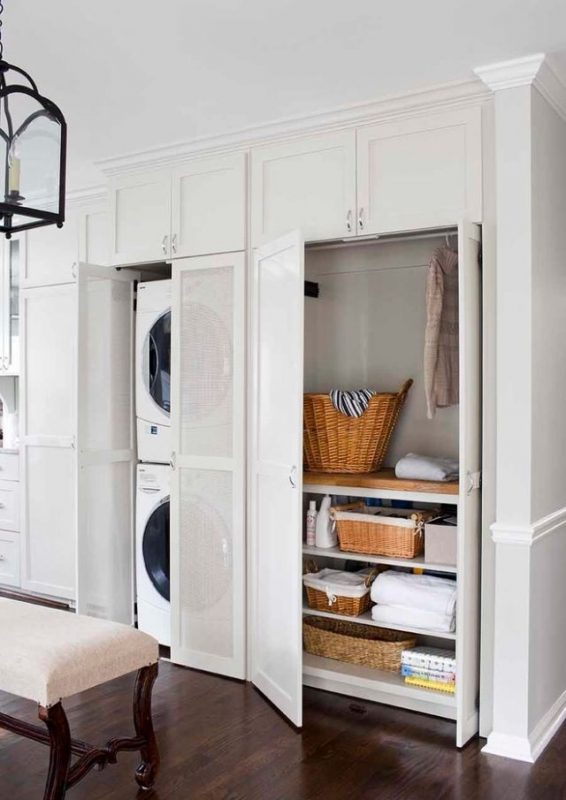 Hidden laundry room in plain sight featured on Remodelaholic.com