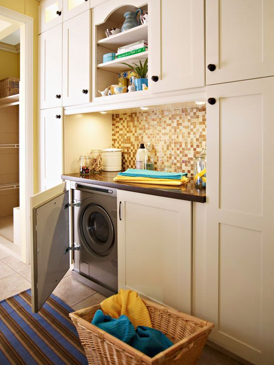 Hidden built in Laundry Space with machines in cabinets featured on Remodelaholic.com