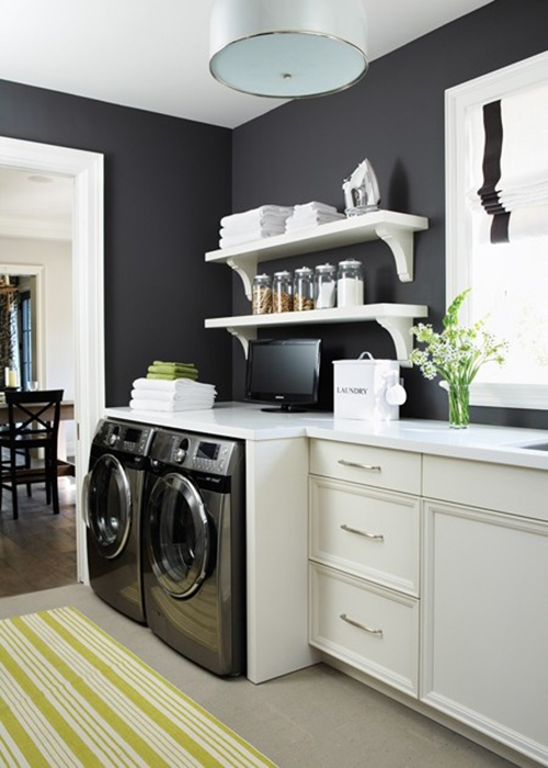 Laundry room in kitchen or mudroom space, black walls and looks beautiful featured on Remodelaholic.com