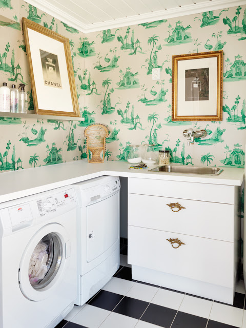 Laundry with stylish wall paper featured in Remodealholic.com's Laundry Room Ideas
