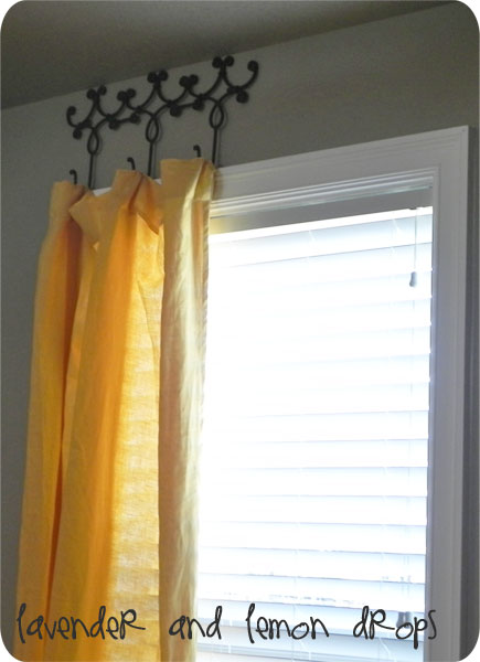 Lavender and Lemon Drops wrought iron coat or towel hanger to hang curtains via Remodelaholic