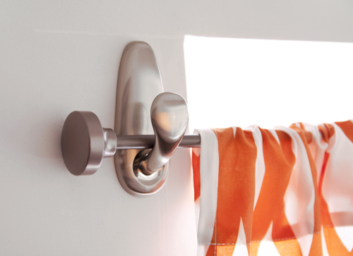 Living in a Nutshell adhesive wall hooks to hang curtain rods via Remodelaholic