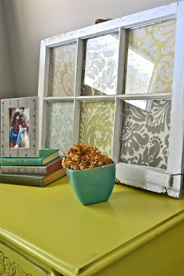 Liz Marie Blog - old window with scrapbook paper - via Remodelaholic