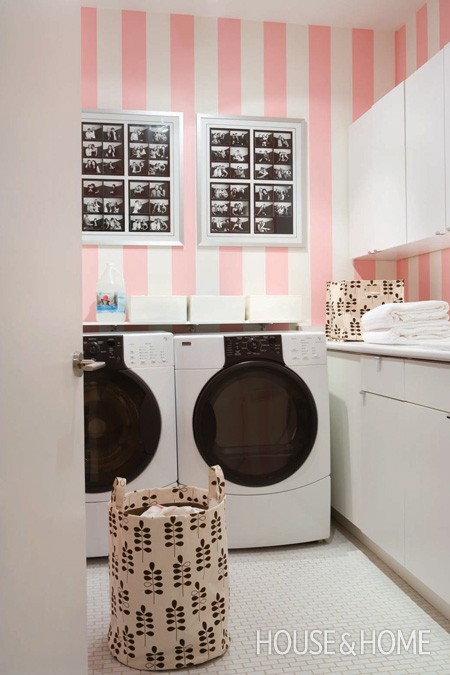 Laundry with pink striped walls House and Home featured on Remodelaholic.com
