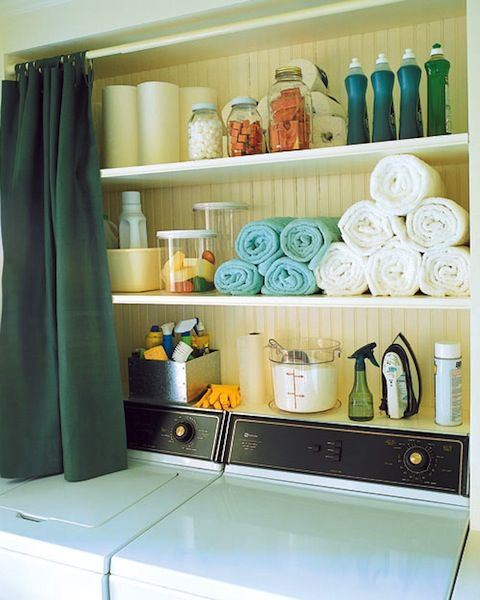 Organized shelves above washing machine