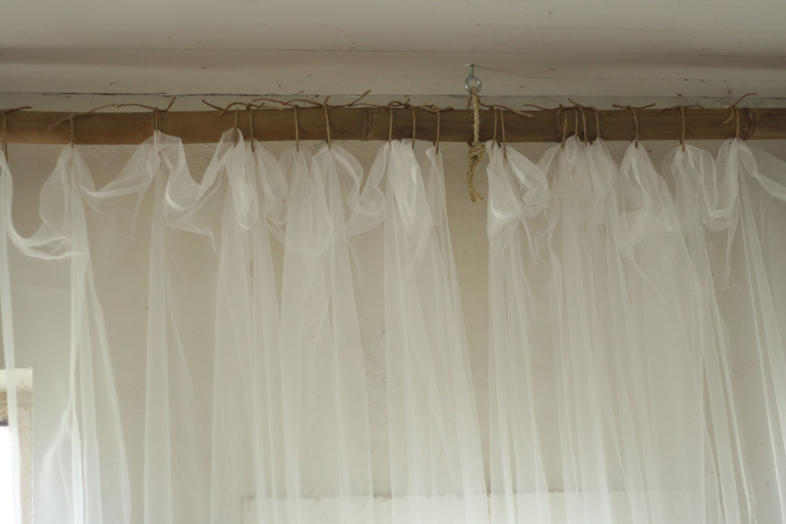 Unique curtain hanging ideas - Primitive And Proper Jute Rope And Bamboo Curtain Hanging System Via Remodelaholic