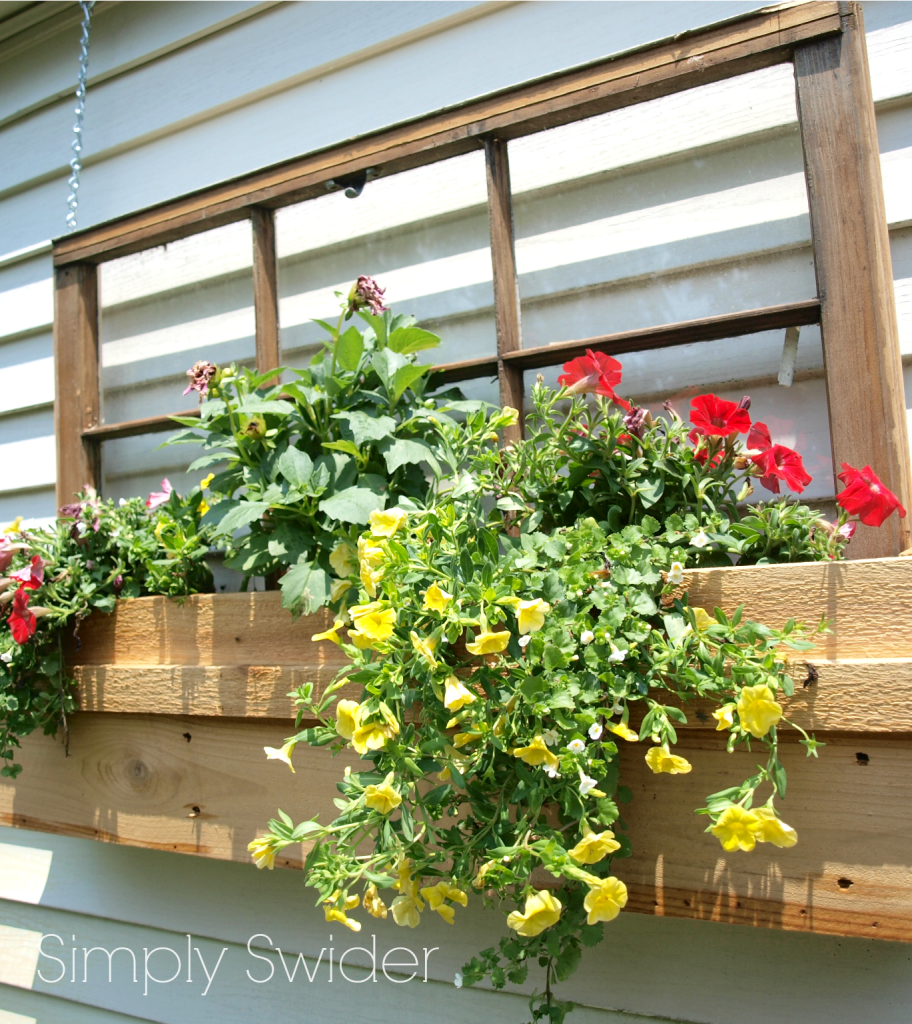 Remodelaholic 100 ways to use old windows for Flower garden box ideas