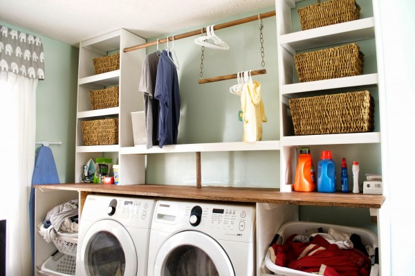 built-in laundry unit with storage baskets, Seesaws and Sawhorses on Remodelaholic