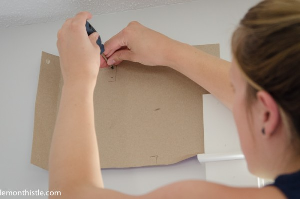 cardboard template makes hanging curtain rods easy, Lemon Thistle on Remodelaholic