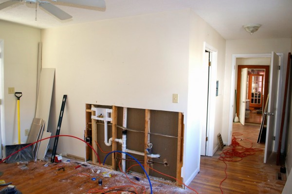 creating a laundry room in a bedroom, Seesaws and Sawhorses on Remodelaholic