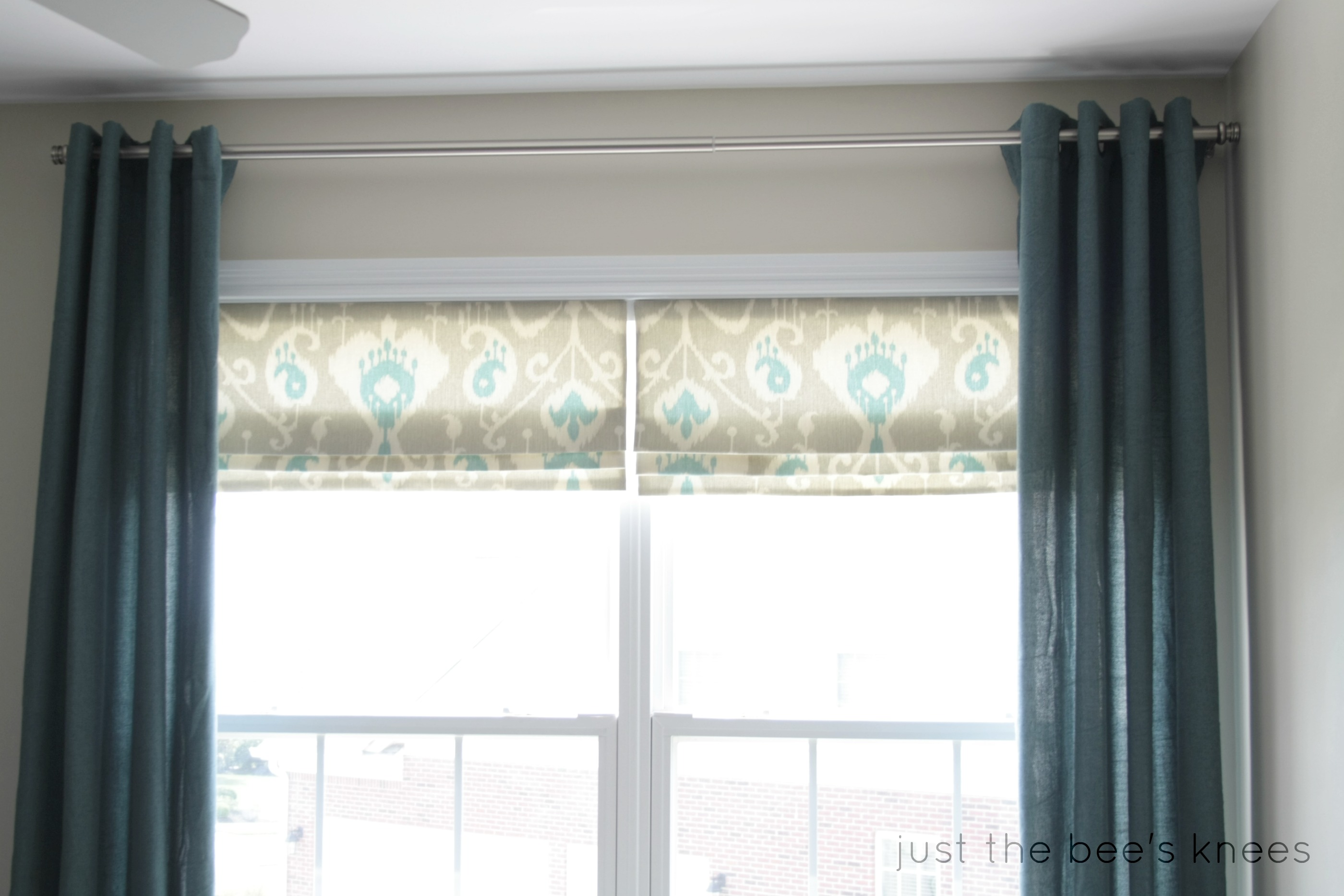 Remodelaholic how to create a faux roman shade for Roman shades that hang from a curtain rod