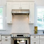 feature renovated kitchen with white subway tile marble and farmhouse sink, Cobblestone DG on Remodelaholic