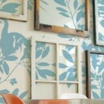 feature salvaged old window gallery wall on patterned wallpaper - via Remodelaholic
