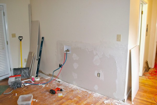 installing washer and dryer hookups 2, Seesaws and Sawhorses on Remodelaholic