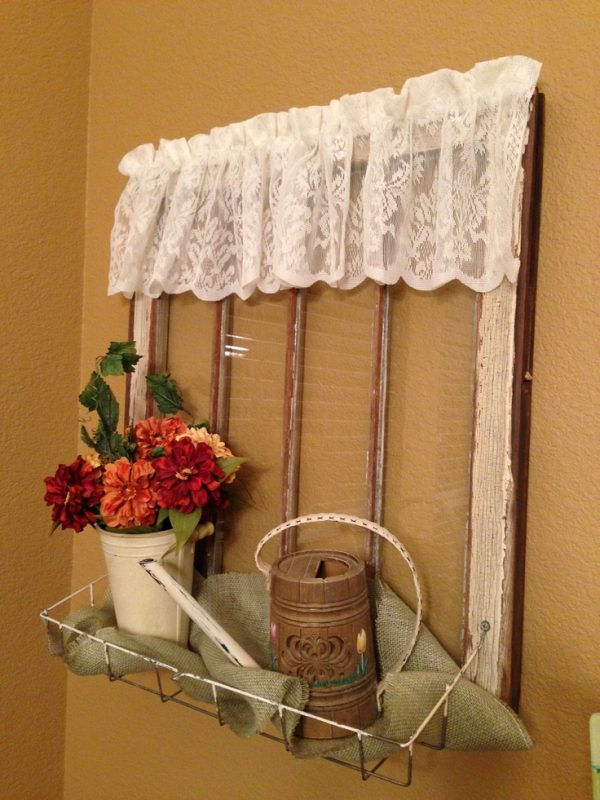 source unknown - add a wire basket to an old window to use as an organizer - via Remodelaholic