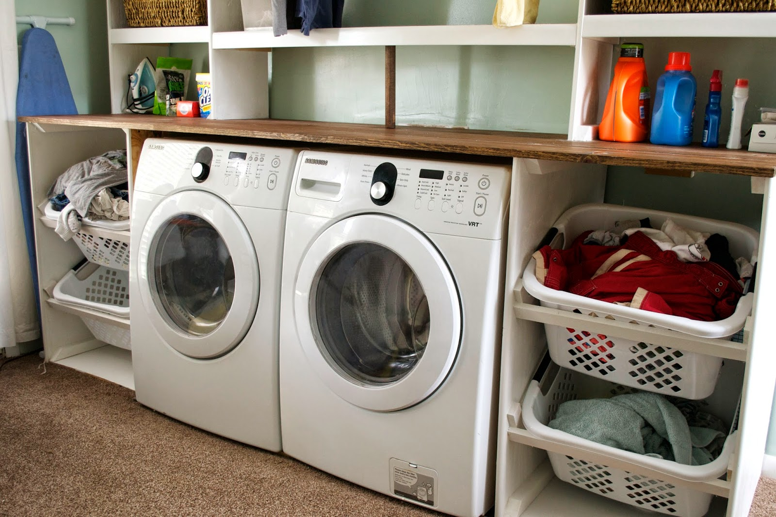 Tilted Laundry Basket Storage In Unit Seesaws And Sawhorses On Remodelaholic
