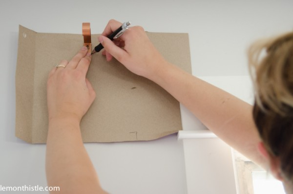 use cardboard to create a template for hanging curtains rods, Lemon Thistle on Remodelaholic