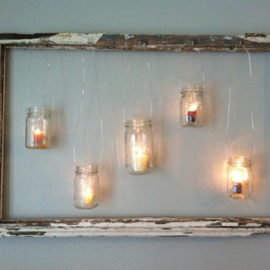via Beauty and Bedlam - hang mason jars and tealights in an old window - via Remodelaholic