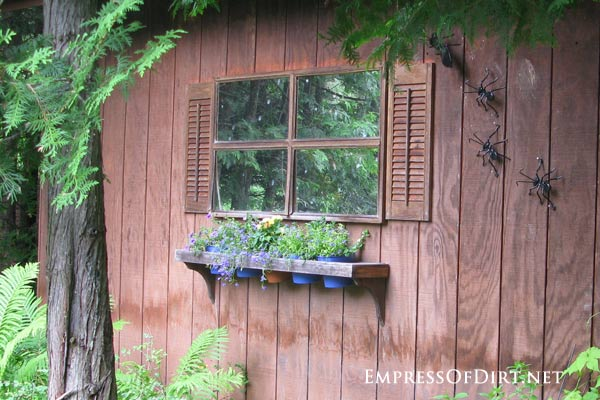 via Empress of Dirt - mirrored window and shutters in garden - via Remodelaholic