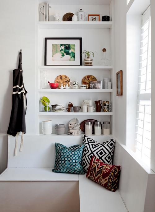 Designer Fluff via Decor8 - corner window seat with built-in shelves via @Remodelaholic