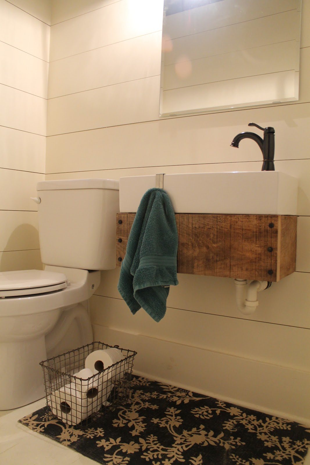 Remodelaholic sliding barn door pantry makeover with for Floating pedestal sink