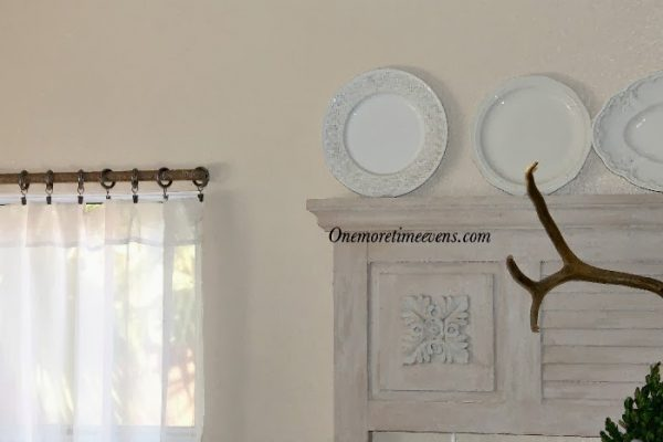 One More Time Events - quick curtain rod facelift via @Remodelaholic