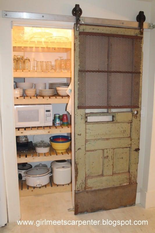 barn door pantry makeover, Girl Meets Carpenter on @Remodelaholic