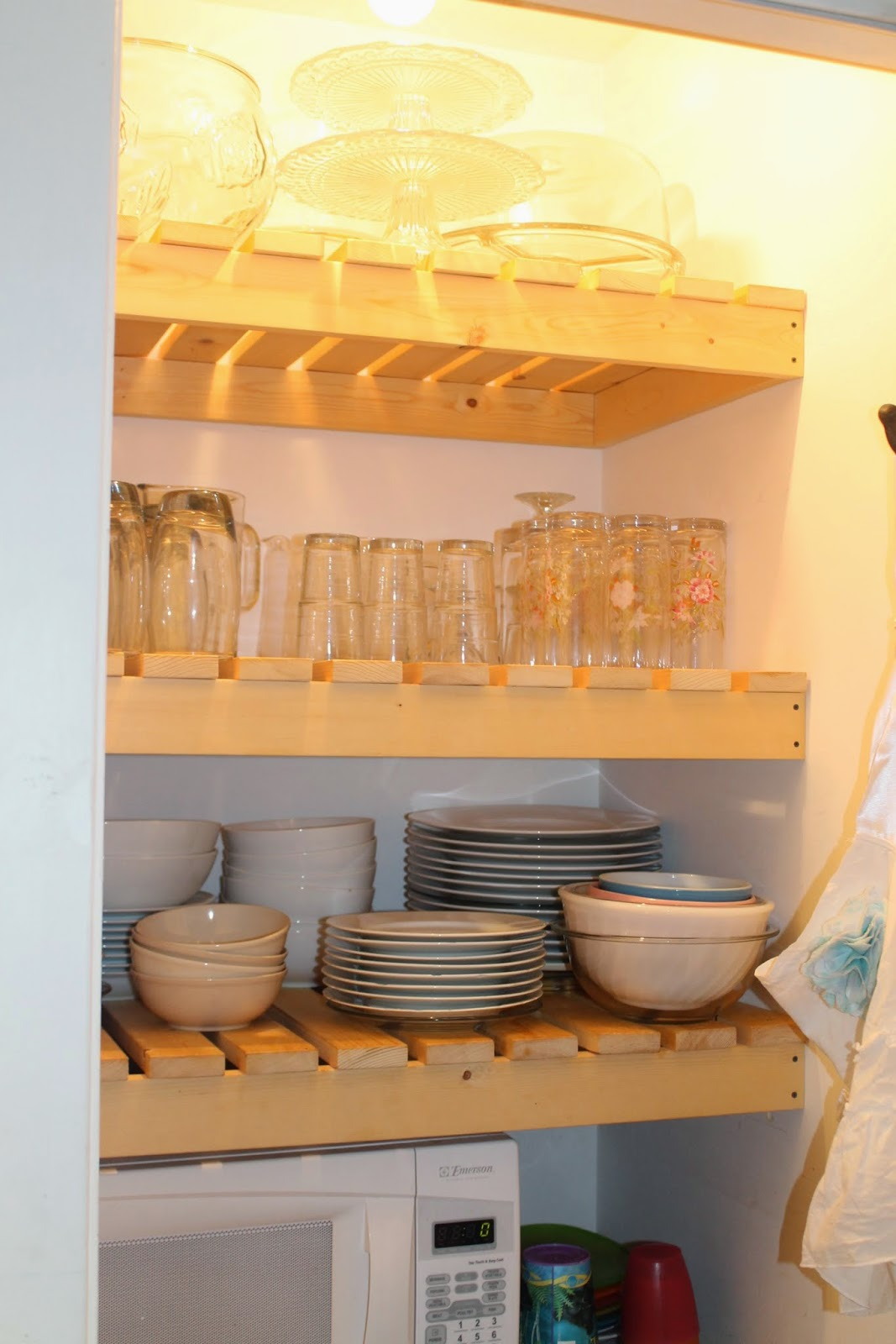 Remodelaholic sliding barn door pantry makeover with wood slat diy wood slat pantry shelves with dishes girl meets carpenter on remodelaholic solutioingenieria Choice Image
