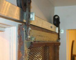 feature sliding barn door for pantry using old meat hooks, Girl Meets Carpenter on @Remodelaholic