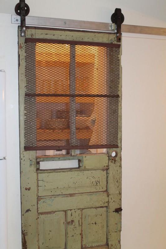 pantry barn door from vintage door and meat hooks, Girl Meets Carpenter on @Remodelaholic