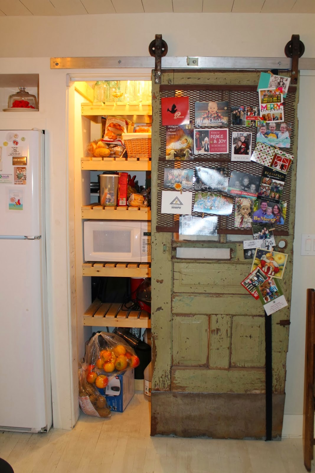 Marvelous photograph of pantry storage on wood slat shelves with sliding barn door Girl Meets  with #C68C05 color and 1067x1600 pixels