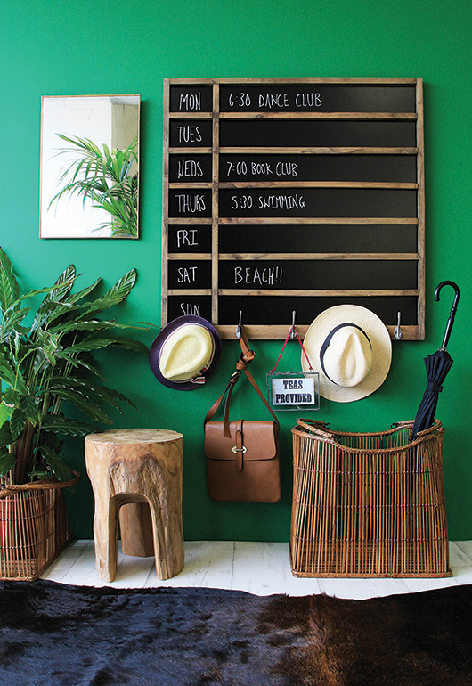 Organize your family with a divided chalkboard calendar with hooks.  Free DIY plans and tutorial on #remodelaholic #organization
