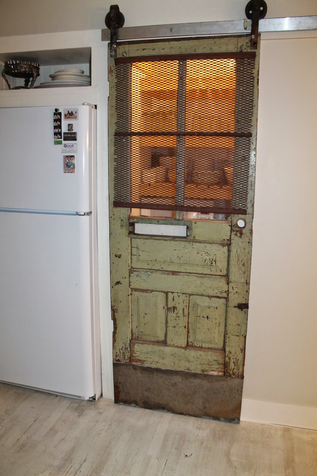 Remodelaholic sliding barn door pantry makeover with for Barn door screen door