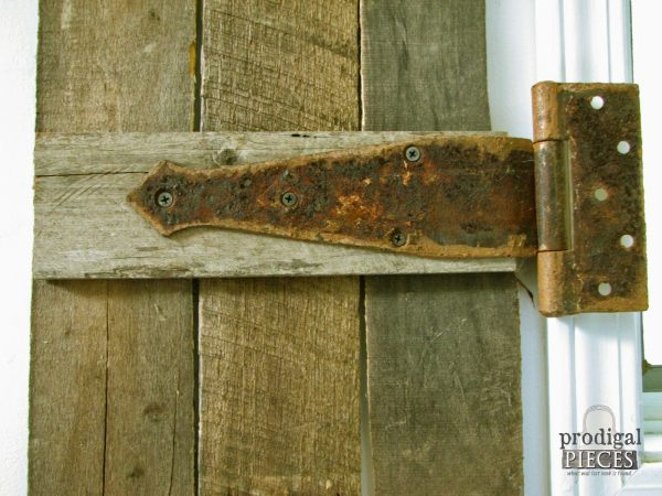 weathered rusty hinge on interior barnwood shutter made from pallets, Prodigal Pieces on Remodelaholic
