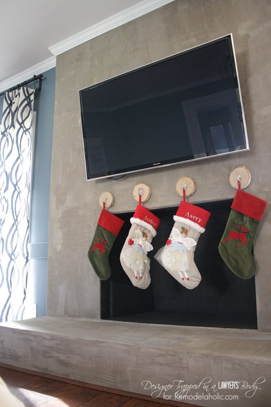 You can hang stockings without a mantel, by Designer Trapped in a Lawyer's Body featured on Remodelaholic