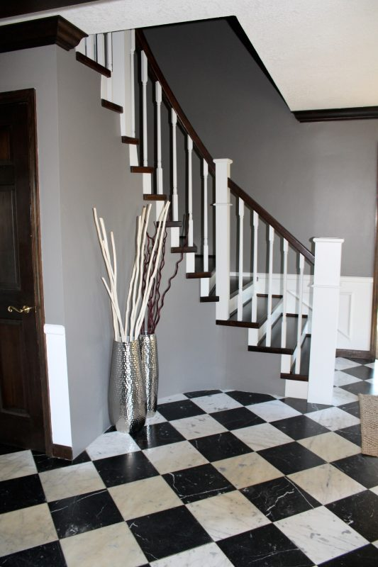 checkered tile floor and diy wood staircase remodel - Construction2Style via @Remodelaholic