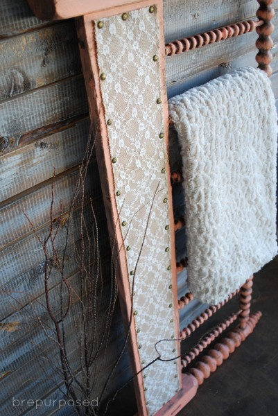 headboard turned quilt rack - Brepurposed via @Remodelaholic