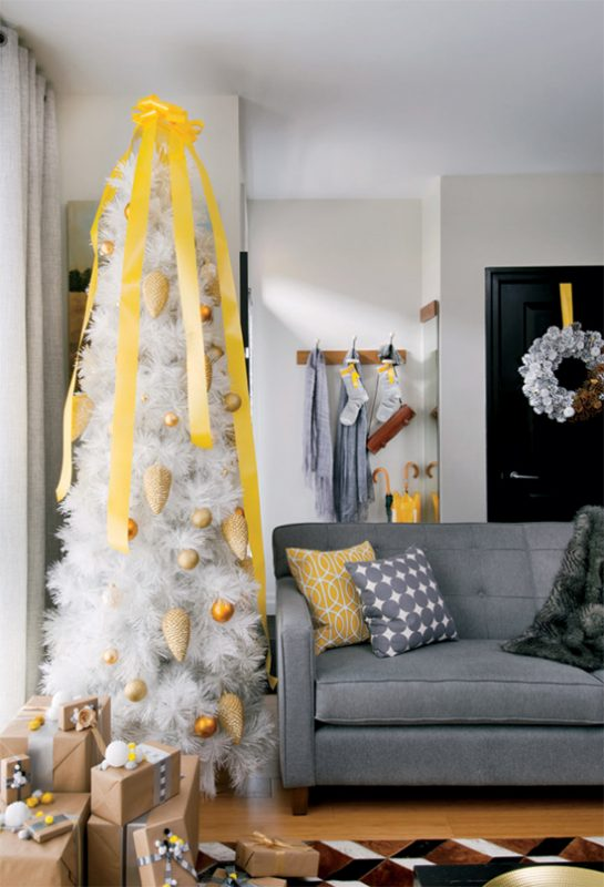 minimalist yellow and white christmas tree via @Remodelaholic