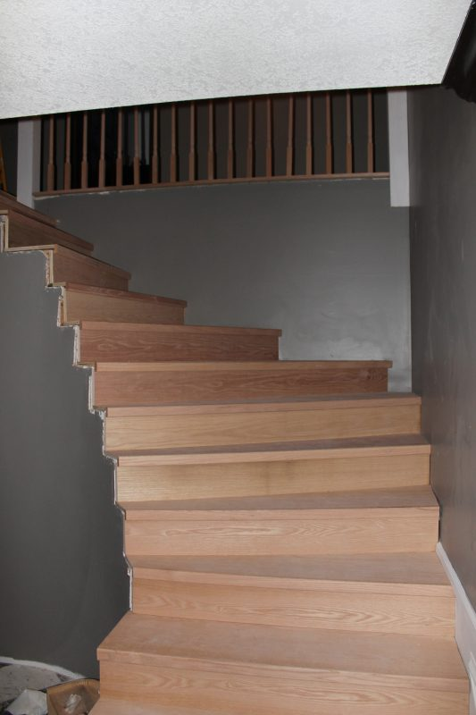 stair remodel with new wood treads - Construction2Style via @Remodelaholic