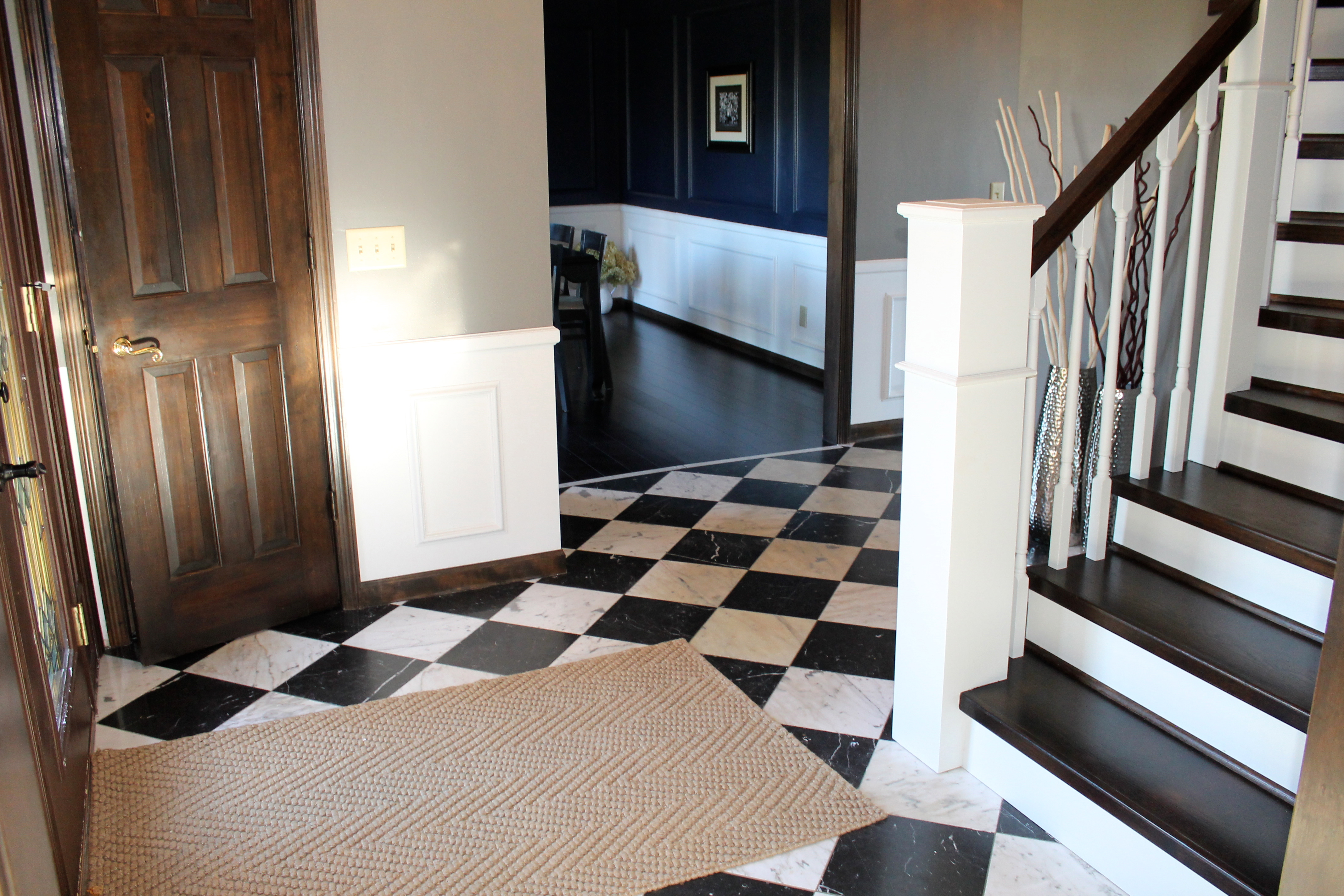 Tile Checker Entryway With Wood And White Curved Staircase    Construction2Style Via @Remodelaholic