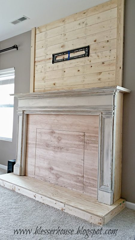 DIY faux fireplace with plank wall chimneypiece Blesser House featured on @Remodelaholic 450x800