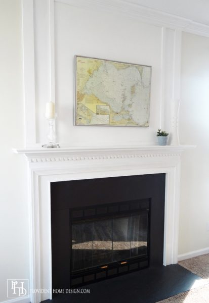 How to Add Woodwork Trim Above a Fireplace Mantel - Provident Home Design featured on @Remodelaholic