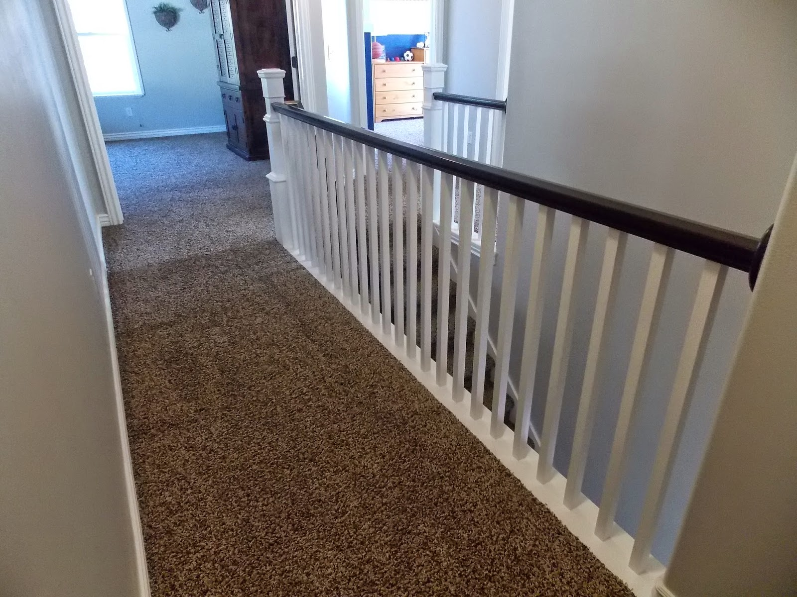banister after replacing spindles and building newel post around existing tda decorating and design featured